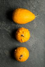 Overhead Of Three Ornamental Yellow Gourd