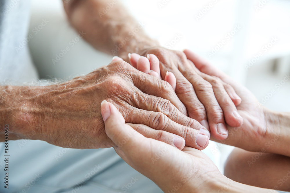 Fototapety, obrazy: Young woman holding senior man hands, closeup