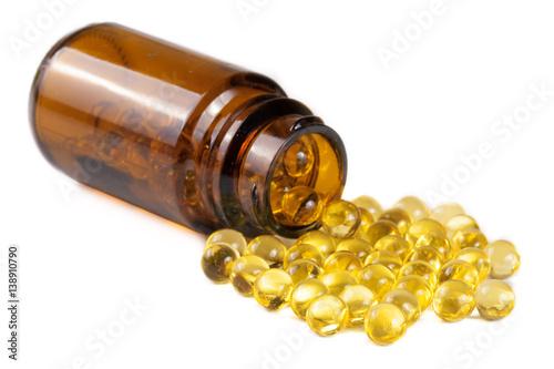 Fototapeta Fish oil capsules in a glass bottle isolated on white background obraz na płótnie