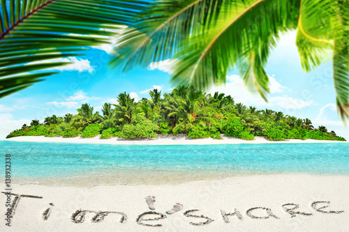 Whole tropical island within atoll in tropical Ocean and inscription TimeShare in the sand on a tropical island,  Maldives Wallpaper Mural