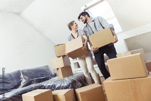 Fotografie, Obraz  Young couple moving into their new home