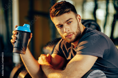 Fotografia  Handsome man resting during a workout at the gym