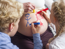 Children Painting On Pregnant Mother's Belly