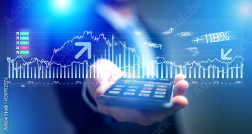 Valokuvatapetti Trading data information going out the smartphone of a businessman