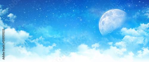 Moon light in a cloudy blue sky