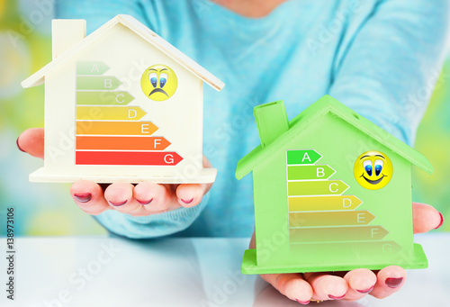фотография  concept comparison between normal house and low consumption house with energy ef