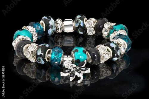 Fashion jewelry bangle beads background black Canvas Print