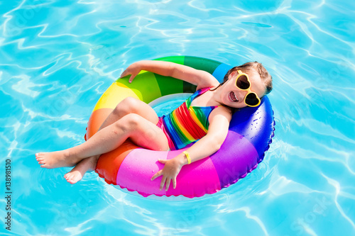 Obraz Child with toy ring in swimming pool - fototapety do salonu