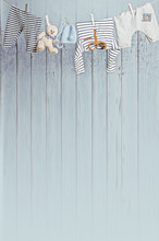 Baby Clothes Hanging On The Clothesline