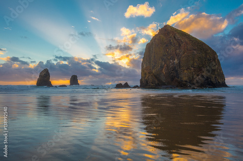 Fototapeta Dramatic sunset over haystack rock
