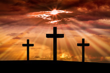 Jesus Christ Cross On A Background With Dramatic Sky,lighting,red, Orange Sunset,clouds,sunbeams,sun Rays Glowing Behind Three Crosses On Golgotha Mountain.Easter, Resurrection, Good Friday Concept.