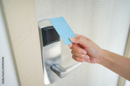A access card holding in asian woman hand for door access