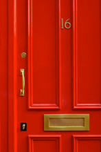 Detail Close-up Of A Bright Red Door In London England