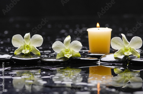 Staande foto Spa still life with black stones and three orchid,candle