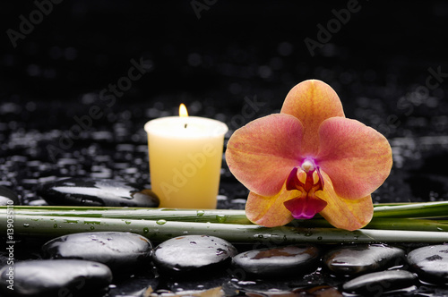 Poster Spa spa concept –orange orchid and long leaf ,candle