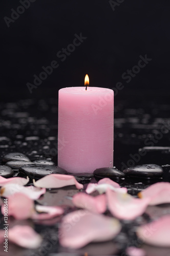 Obraz na plátně  rose petals with candle and therapy stones