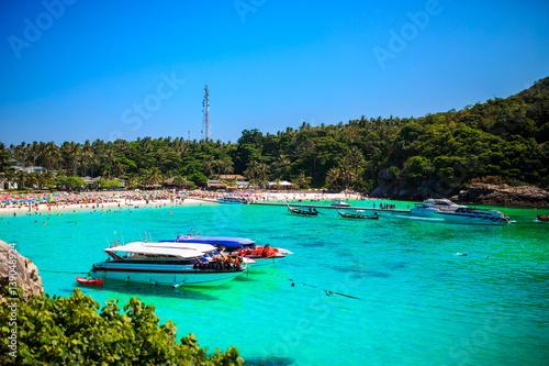 Spoed Foto op Canvas Turkoois Landscape of many boats floating on the deep blue sea in summer.