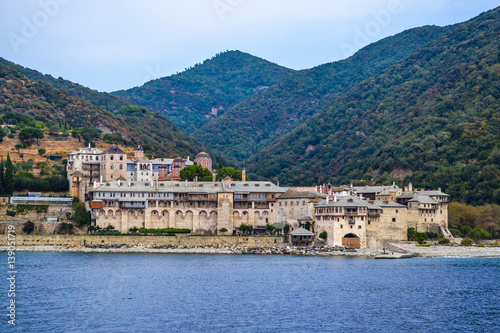 Fotografie, Obraz  Orthodox Greek monastery on Mount Athos. View from sea. Xenophon.