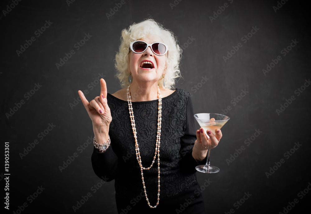 Fototapety, obrazy: Cool grandmother with sunglasses and drink in hand