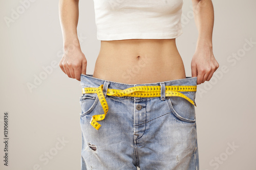 Fotografia  Weight loss woman with bluejeans