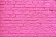 Grunge pink brick wall as background, texture