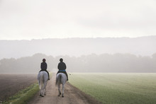 Rear View Of Two Riders On Whi...