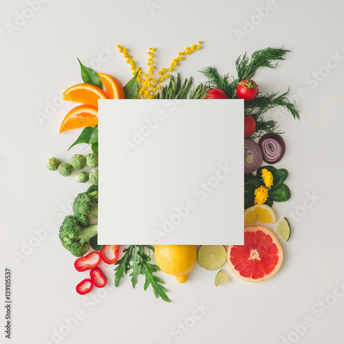 Tuinposter Keuken Creative layout made of various fruits and vegetables with white paper card. Flat lay. Food concept.