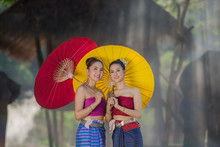 Beautiful Girl Thai Lanna Women In Dress Traditional Costume With Elephant In Chiang Mai, Thailand