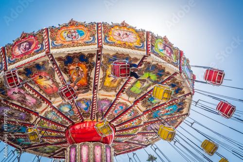 A colorful fair swinging ride. Slika na platnu