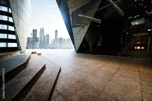 Canvas Prints Kuala Lumpur Empty marble stair and floor front of modern polygon design buildings.