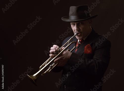 Photo Stands Music Band Mature Jazz man playing a trumpet