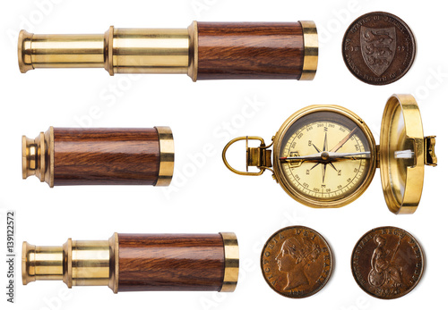 Deurstickers Retro Telescope, compass, and old coins isolated on white background.