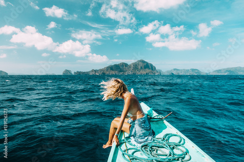 Woman travelling on the boat in Asia