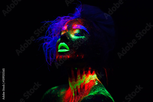 Beautiful extraterrestrial model woman with blue hair and green lips in neon light Wallpaper Mural