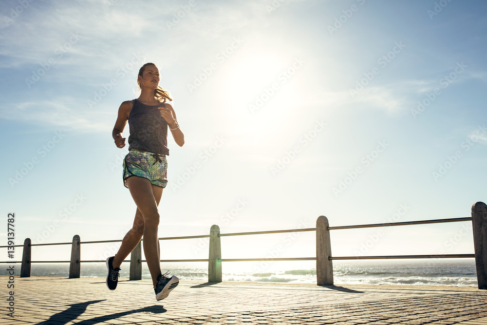 Fototapety, obrazy: Fitness young woman jogging along the beach