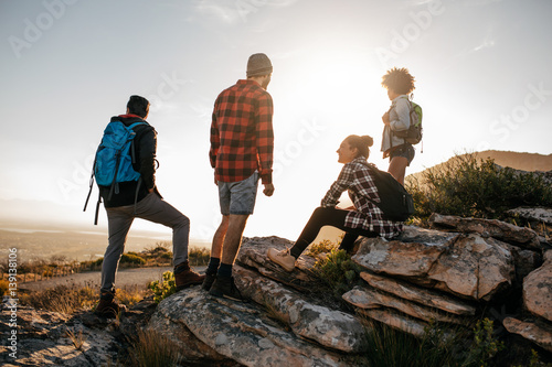 Group of hikers on top of hill and enjoying view