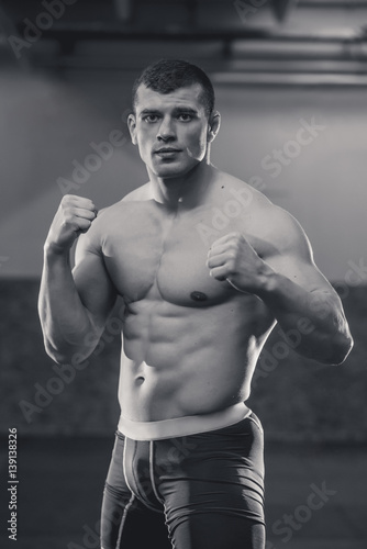 Obraz na plátně Mixed martial arts fighter posing in guard stance