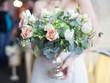 canvas print picture - wedding bouquet in bride's hands