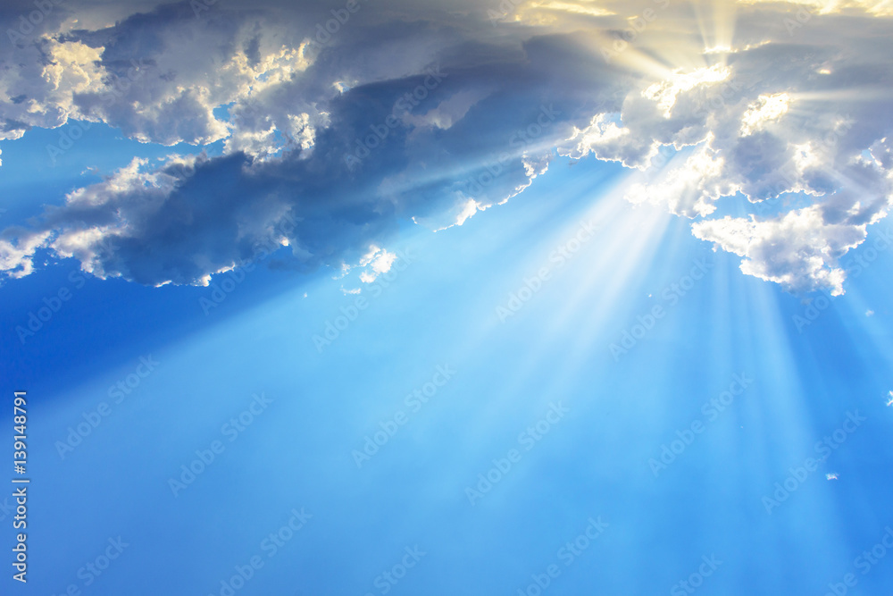Fototapety, obrazy: Sun light rays or beams bursting from the clouds on a blue sky. Spiritual religious background.