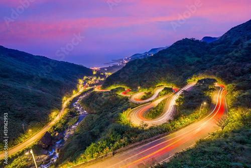 Photo Stands Black Winding Hillside Roads in Jiufen, Taiwan