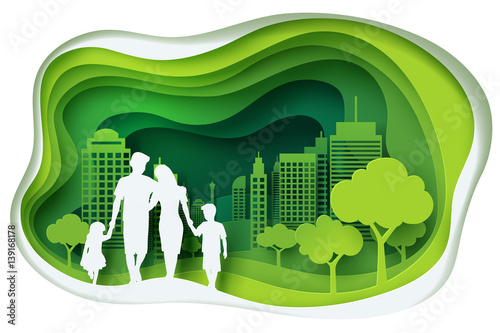 Fotografía  Paper carve to family and park on green town shape, paper art concept and ecolog