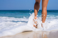 Woman Legs, Walking On The Beach