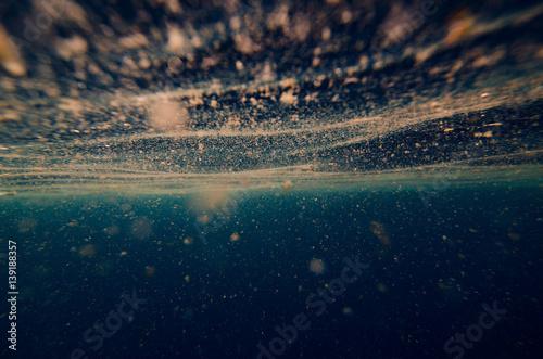 Valokuvatapetti abstract underwater background with plankton