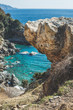 Seascape scenery. Rock over the chasm and beautiful natural lagoon down there at Mediterranean sea coast of Turkey, near Gazipasa town