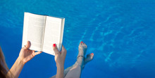 Girl Reading By The Swimming P...