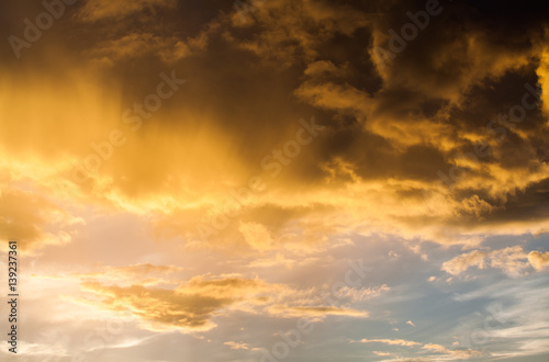 Foto op Plexiglas Zonsondergang colorful dramatic sky with cloud at sunset