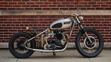 Old Motorcycle Against Brick W...