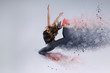 Woman in jump. Frozen motion. Photo manipulation of disintegration