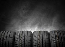 Car Tires On A Dark Background.