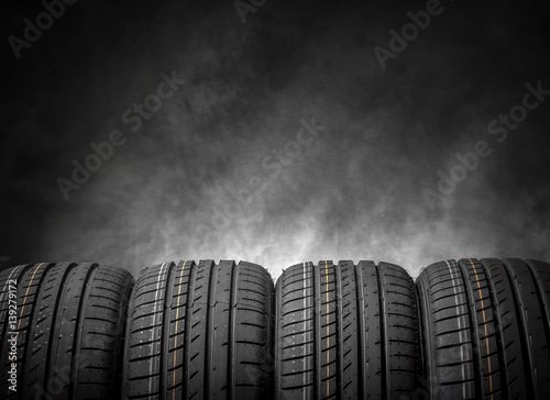 Car tires on a dark background. Fototapet